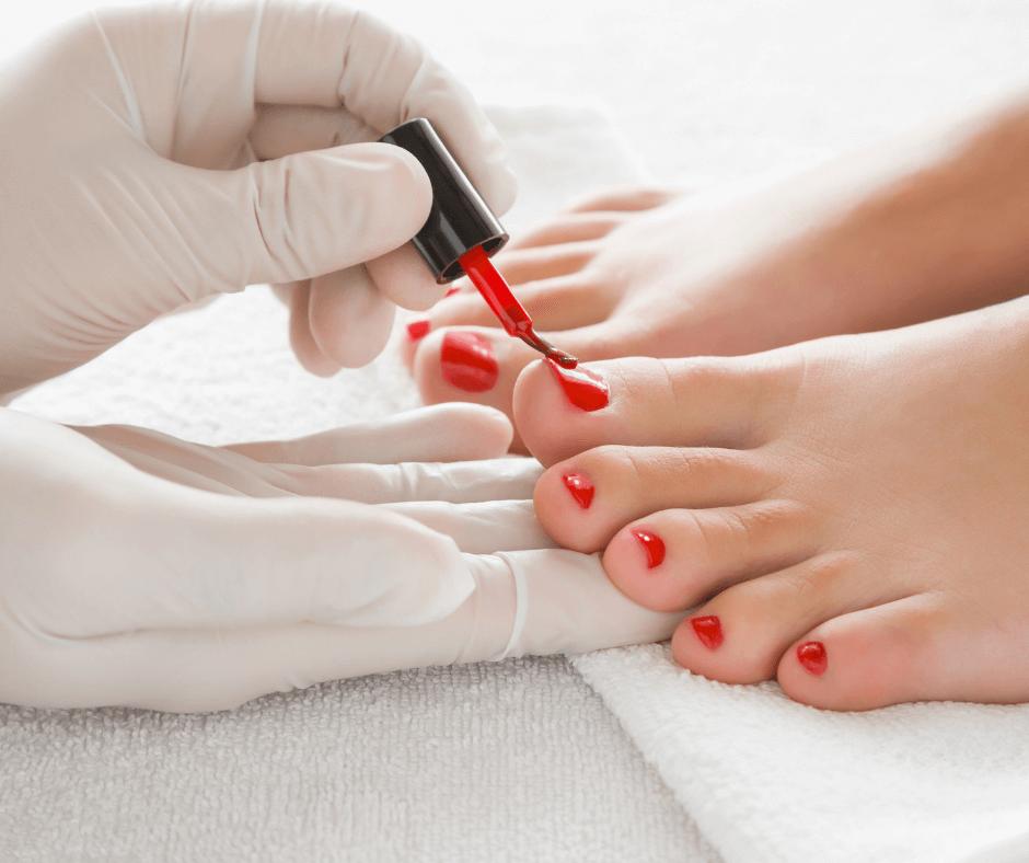 women getting toenails painted