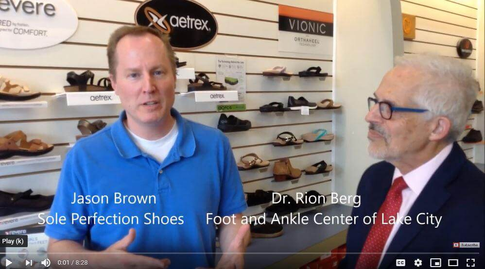 physician talks to shoe store owner