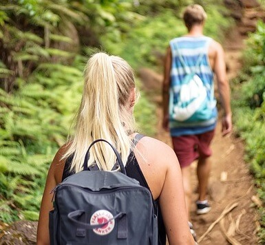 young people hiking in the woods