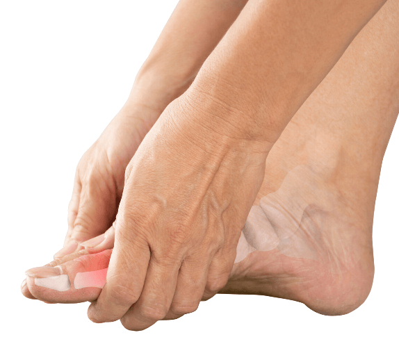 woman holding top of foot