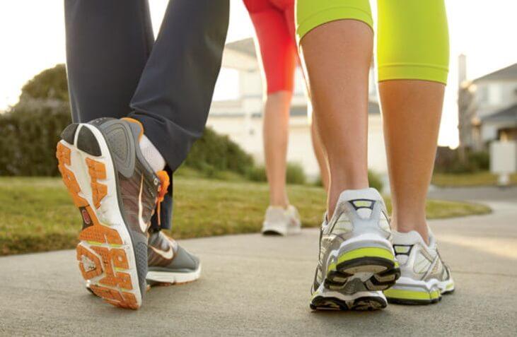 people walking in tennis shoes