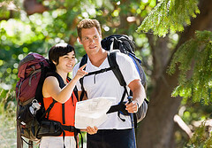 young couple with backpacks on