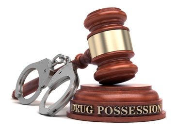 Drug Possession Gavel With a Pair of Handcuffs
