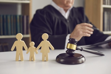 Wooden Family Figurines With a Judge and Gavel