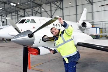 Buyer Inspecting an Airplane