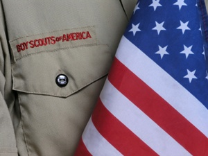 boy scout in uniform with American flag Gray & White