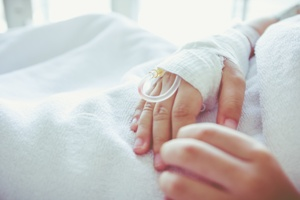child hand with IV chemotherapy