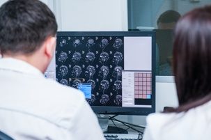 attorneys reviewing brain scan test results