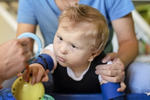 baby with cerebral palsy getting rehabilitation therapy