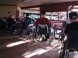 back view of veterans in wheelchairs