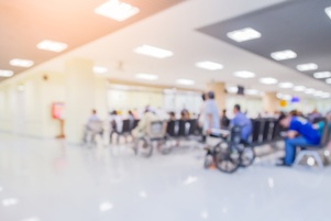 blurred image of a busy hospital emergency room