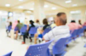 blurred image of people waiting in a hospital emergency room