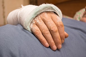 A man displays a bandage protecting a recent nursing home burn injury