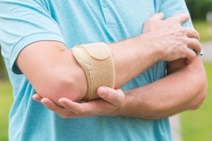 bursitis caused by car accident Gray and White Law