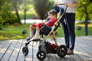 child with cerebral palsy in a wheelchair stroller