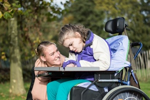 child in wheelchair with cerebral palsy