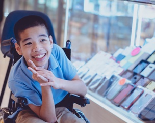 child with cerebral palsy smiling in wheelchair