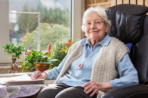content nursing home resident smiling at camera