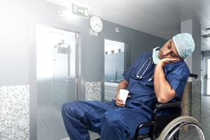 doctor asleep in hospital hallway wheelchair