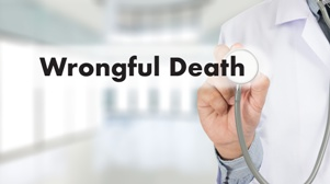 doctor with stethoscope and words wrongful death on screen
