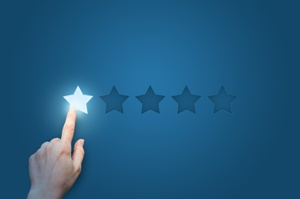 finger pressing one star out of five