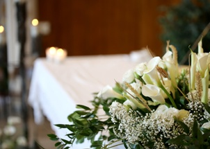 flower arrangement on a casket at a funeral