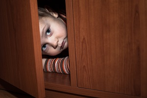 A child hides from abusive daycare providers