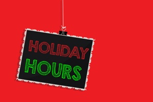 holiday hours hanging sign