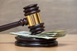 judge's gavel on a pile of money