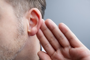 man-with-hearing-loss-holding-his-ear