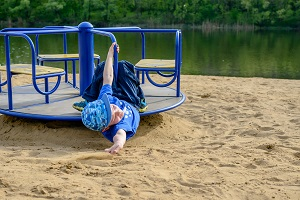 A boy suffers a merry-go-round accident while playing without proper supervision
