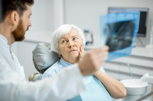 nursing home resident with toothache Gray & White