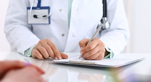oncologist writing chemotherapy prescription