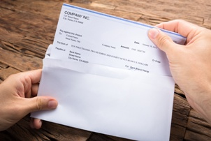 person opening paycheck
