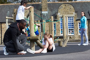 A child has been hurt by a fall on the playground of a daycare facility