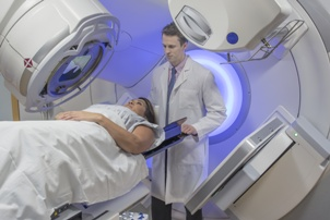radiation oncologist treating breast cancer patient