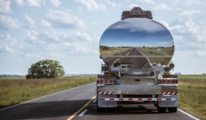 rear view of a tanker truck on the highway