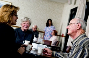 residents in assisted living social hour