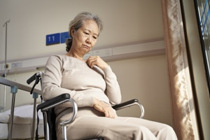sad older woman in wheelchair nursing home neglect