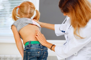 scoliosis caused during labor or delivery