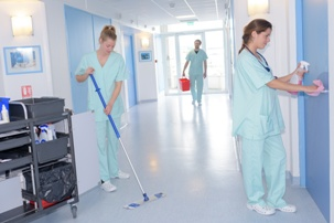 staff cleaning and repairing nursing home