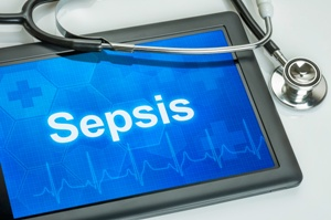 tablet showing word sepsis and stethoscope