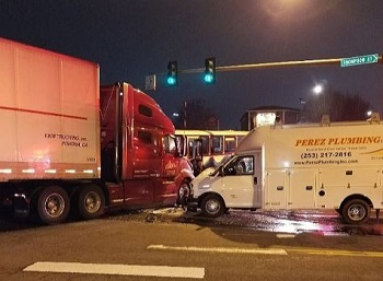 picture of semi truck and box truck accident