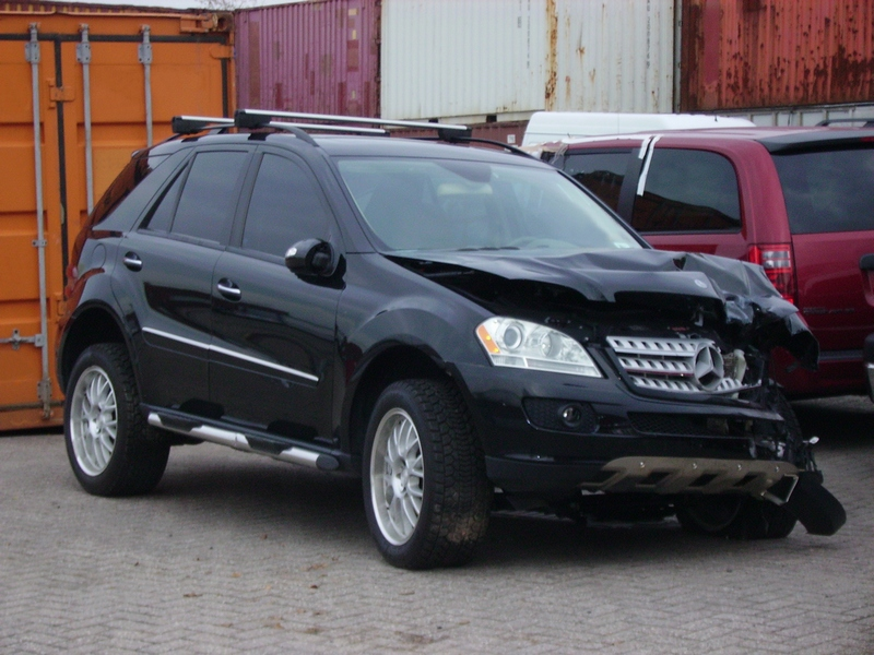 Pictured: A Similar Model Mercedes SUV with some damage. Images from the scene described in this article available at https://komonews.com/news/local/1-dead-1-injured-as-vehicle-collides-with-semi-in-sodo-district