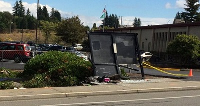 car crash into bus stop