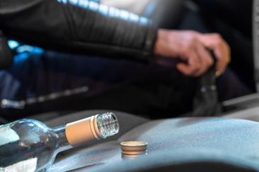 Alcohol Bottle in a Semi-Truck's Cab