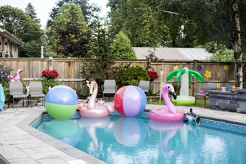 Backyard Pool With Blowup Floating Toys