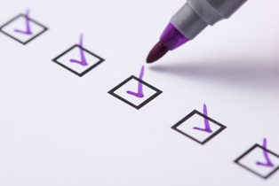Check List With Marker Used to Find the Perfect Lawyer