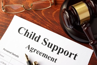 Child Support Agreement With a Wooden Gavel