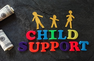 Child Support Spelled Out With Fridge Magnets